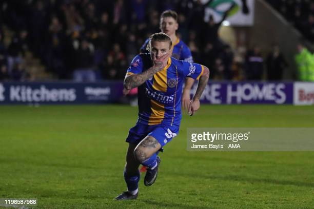 Jason Cummings of Shrewsbury Town celebrates after scoring a goal to make it 12 during the FA Cup Fourth Round match between Shrewsbury Town and...