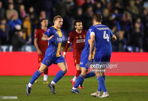 Jason Cummings of Shrewsbury Town celebrates after scoring his team's first goal during the FA Cup Fourth Round match between Shrewsbury Town and...