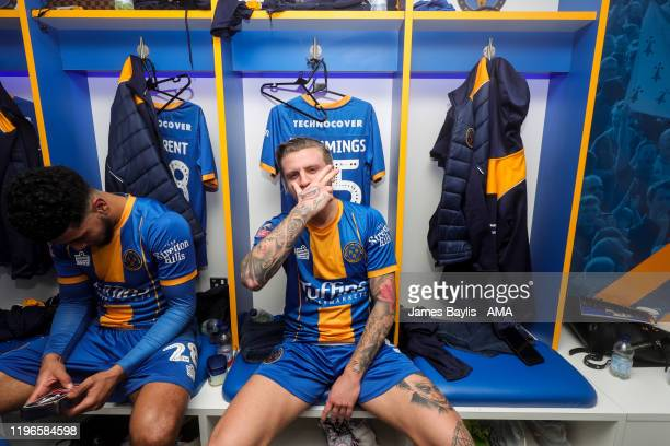Jason Cummings of Shrewsbury Town celebrates in the dressing room at full time during the FA Cup Fourth Round match between Shrewsbury Town and...