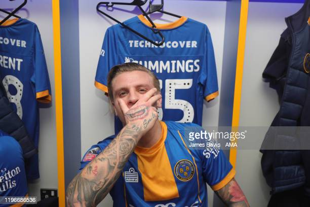 Jason Cummings of Shrewsbury Town celebrates in the dressing room at the end of the gameafter the FA Cup Fourth Round match between Shrewsbury Town...