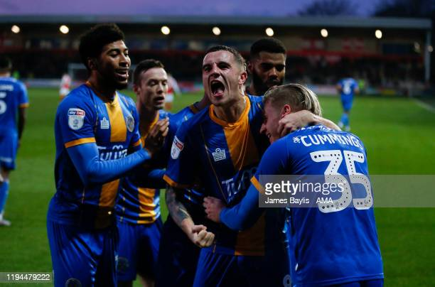 Jason Cummings of Shrewsbury Town celebrates with his team mates after scoring a goal to make it 12 during the Sky Bet League One match between...