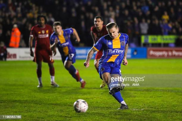 Jason Cummings of Shrewsbury Town scores a goal to make it 12 during the FA Cup Fourth Round match between Shrewsbury Town and Liverpool at New...