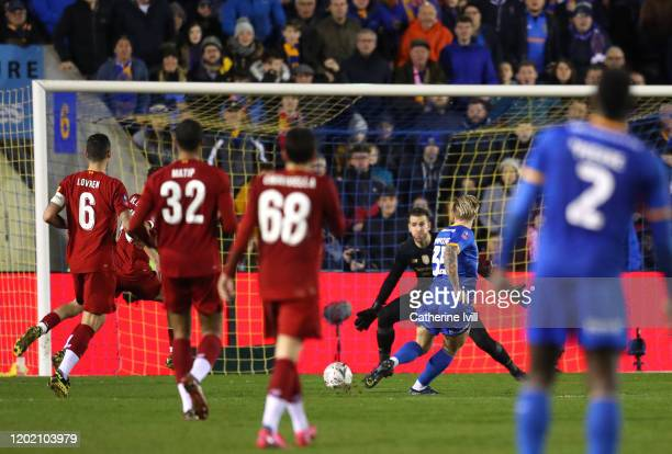 Jason Cummings of Shrewsbury Town scores his team's second goal during the FA Cup Fourth Round match between Shrewsbury Town and Liverpool at New...