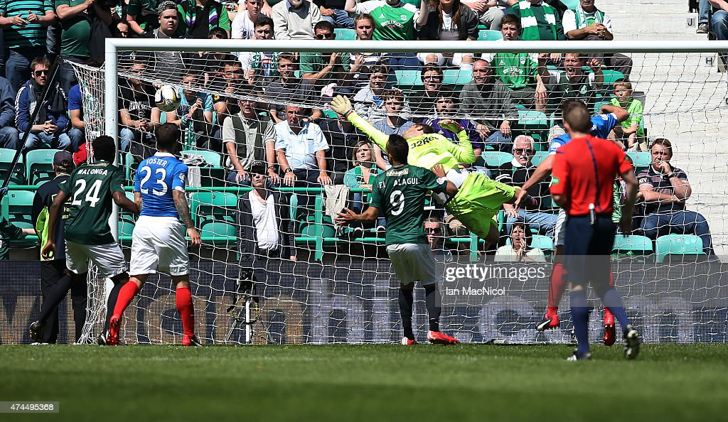 Jason Cummings shot beats Rangers goalkeeper Cammy Bell during the Scottish Championship play off semi final, second leg match between Hibernian and Rangers at Easter Road on May 23, 2015 in Edinburgh, Scotland.