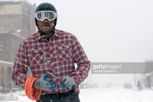 Jason Dahl stands at the finish line after completing a run in the 71st annual Leadville Ski Joring weekend competition under the snow on March 3...
