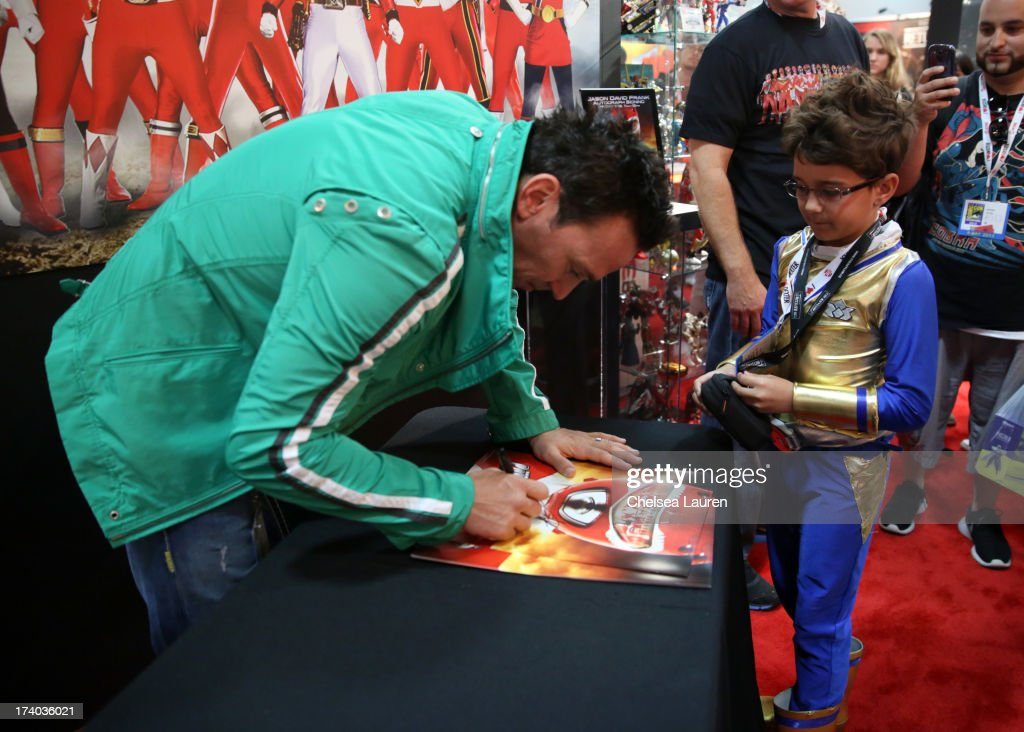 Jason David Frank, the original Green turned White Ranger from the Mighty Morphin Power Rangers, greets fans at Comic-con San Diego during Comic-Con International 2013 at San Diego Convention Center on July 19, 2013 in San Diego, California.