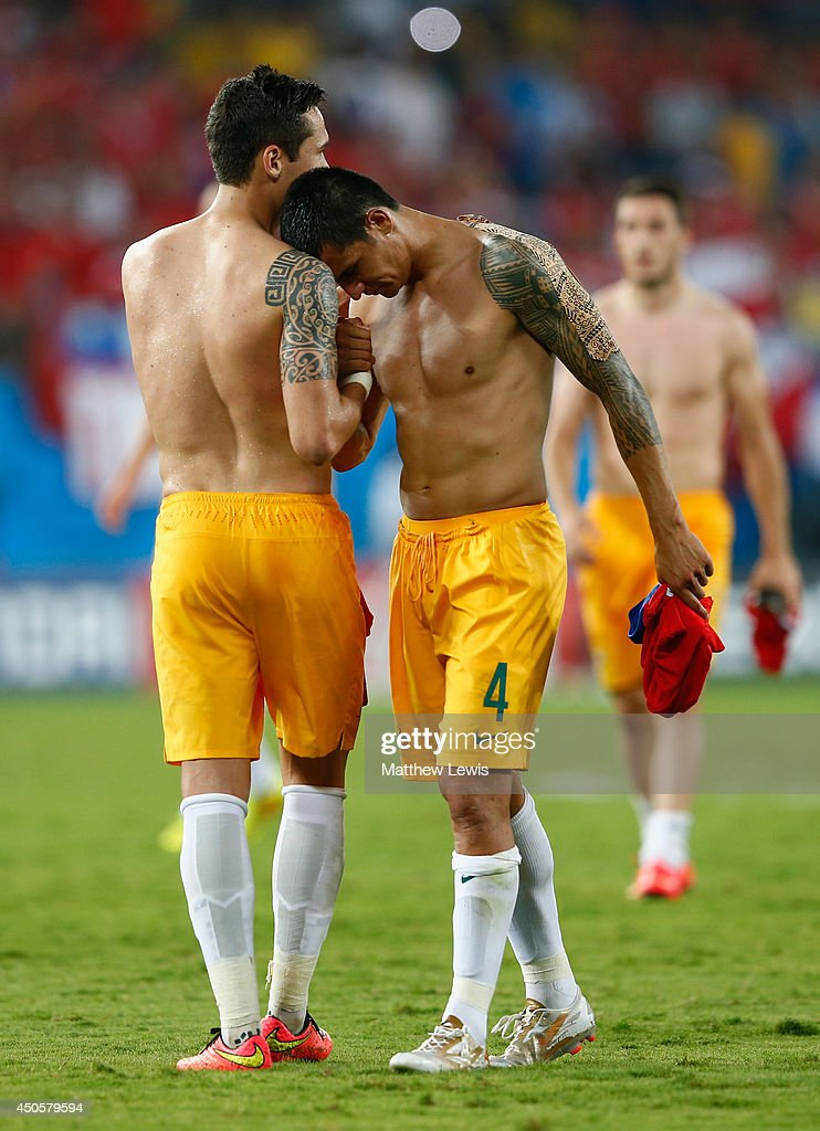Jason Davidson (L) and Tim Cahill of Australia embrace after being defeated by Chile 3-1 during the 2014 FIFA World Cup Brazil Group B match between Chile and Australia at Arena Pantanal on June 13, 2014 in Cuiaba, Brazil.