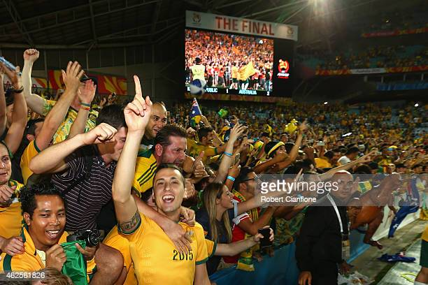 Jason Davidson of Australia celebrates with fans after Australia defeated Korea Republic during the 2015 Asian Cup final match between Korea Republic...