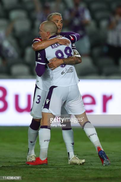 Jason Davidson of Perth Glory hugs team mate Neil Kilkenny after a goal during the round 24 ALeague match between the Central Coast Mariners and the...