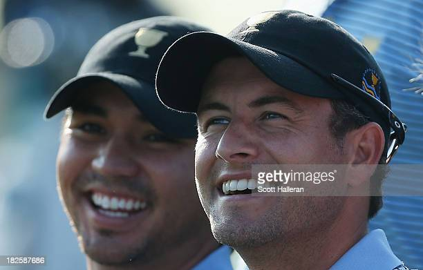 Jason Day and Adam Scott of Australia and the International Team pose during a photocall on the practice ground prior to the start of The Presidents...