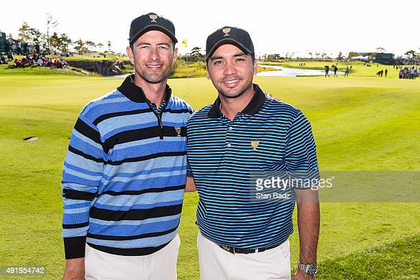 Jason Day and Adam Scott of Australia on the International Team pose following their 1up victory after Day's birdie putt on the 18th hole green...