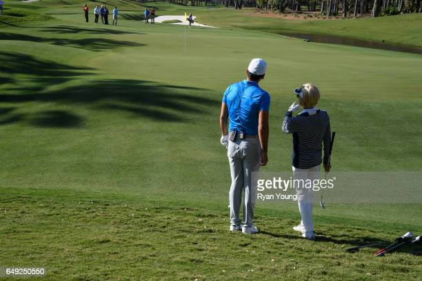 Jason Day and Laura Baugh line up a chip on the 12th hole during THE PLAYERS Media Day and Charity Challenge with 2016 Champion Jason Day at TPC...
