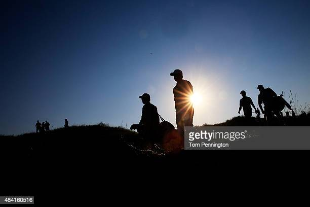 Jason Day and Matt Jones of Australia walk with their caddies off the 15th tee during the third round of the 2015 PGA Championship at Whistling...