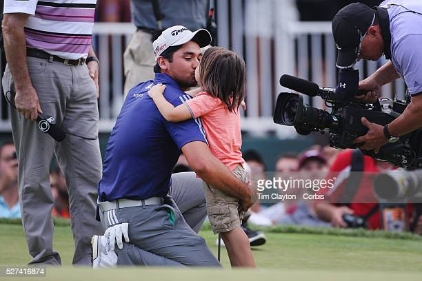 Jason Day Australia is greeted by his son Dash after winning the The Barclays Golf Tournament by six shots at The Plainfield Country Club Edison New...