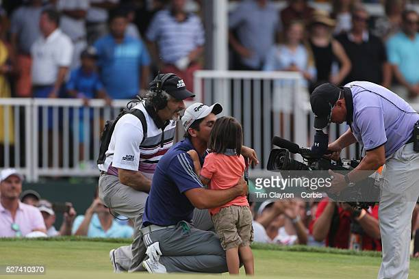 Jason Day Australia receives hugs and kisses from his son Dash after winning the The Barclays Golf Tournament by six shots at The Plainfield Country...