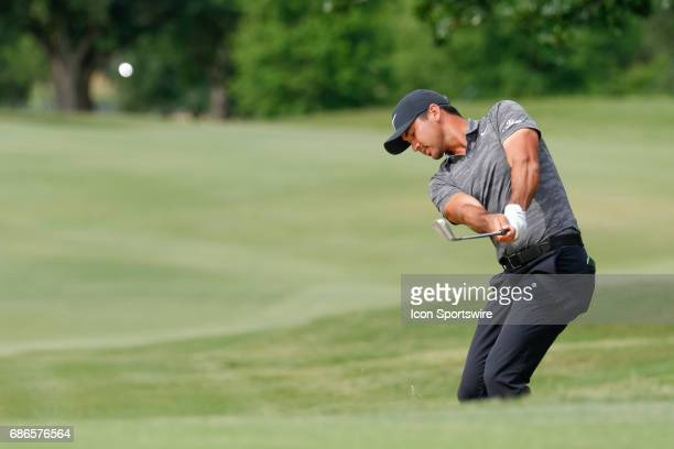 Jason Day chips in from the green side rough on during the final round of the ATT Byron Nelson on May 21 2017 at the TPC Four Seasons Resort in...