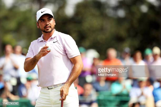 Jason Day of Australia acknowledges patrons on the 18th green during the second round of the Masters at Augusta National Golf Club on April 12, 2019...