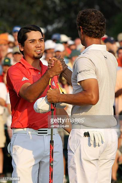 Jason Day of Australia and Adam Scott of Australia celebrate after finishing on the 18th hole during the final round of the 2011 Masters Tournament...