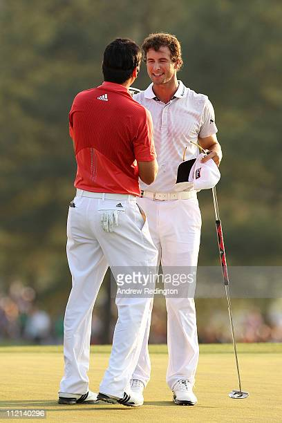 Jason Day of Australia and Adam Scott of Australia congratulate each other on the 18th hole during the final round of the 2011 Masters Tournament at...