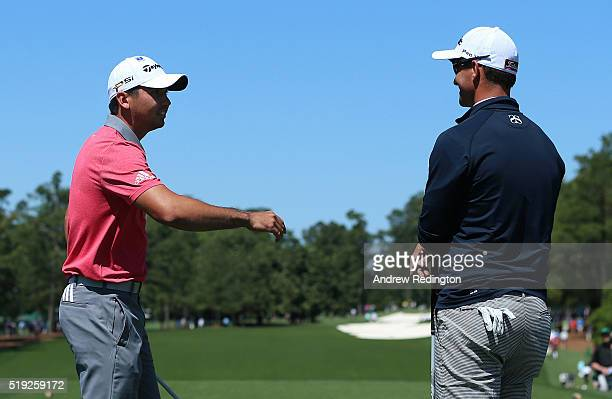 Jason Day of Australia and Adam Scott of Australia talk on a tee box during a practice round prior to the start of the 2016 Masters Tournament at...