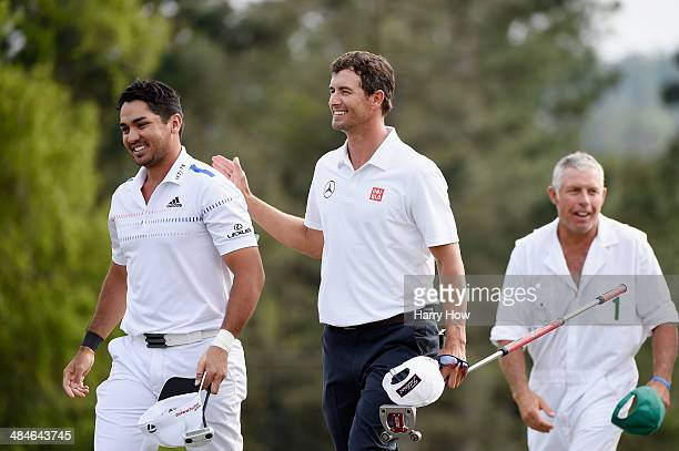 Jason Day of Australia and Adam Scott of Australia walk off the 18th hole during the final round of the 2014 Masters Tournament at Augusta National...
