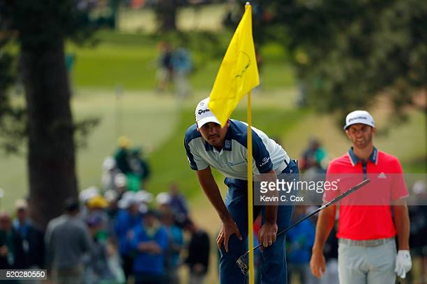 Jason Day of Australia and Dustin Johnson of the United States stand on the seventh green during the final round of the 2016 Masters Tournament at...