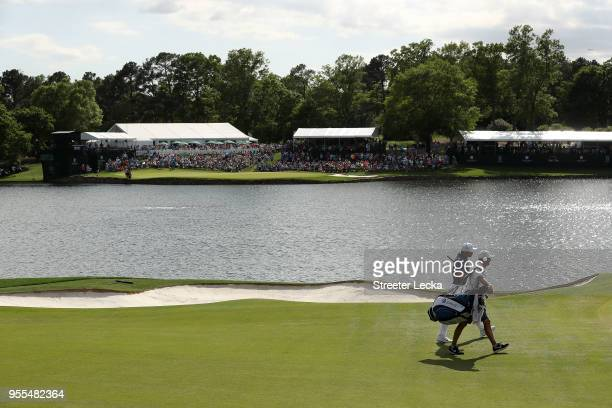 Jason Day of Australia and his caddie Luke Reardon walk the 14th hole during the final round of the 2018 Wells Fargo Championship at Quail Hollow...