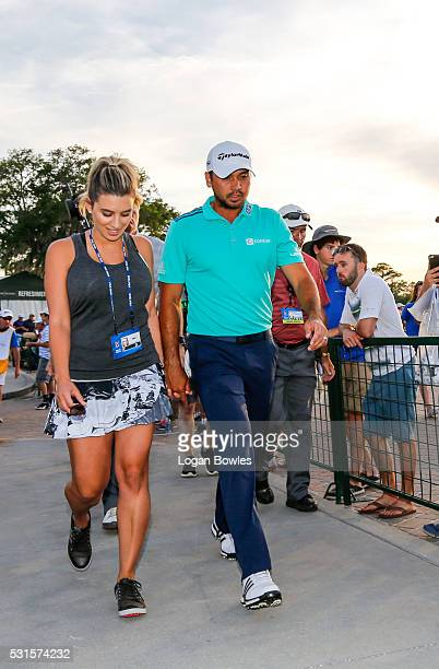 Jason Day of Australia and his wife Ellie Day walk toward the clubhouse during the third round of THE PLAYERS Championship on THE PLAYERS Stadium...