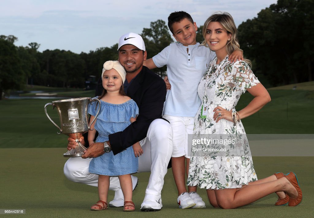 Jason Day of Australia and his wife Ellie pose with their children, Dash and Lucy, on the 18th green after winning the 2018 Wells Fargo Championship at Quail Hollow Club on May 6, 2018 in Charlotte, North Carolina.