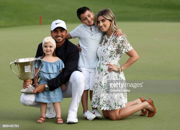 Jason Day of Australia and his wife Ellie pose with their children Dash and Lucy on the 18th green after winning the 2018 Wells Fargo Championship at...