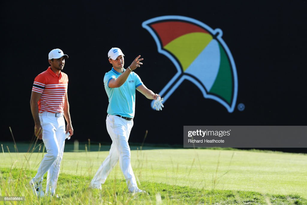Jason Day of Australia and Martin Kaymer of Germany walk on the 18th hole during the second round of the Arnold Palmer Invitational Presented By MasterCard at Bay Hill Club and Lodge on March 17, 2017 in Orlando, Florida.