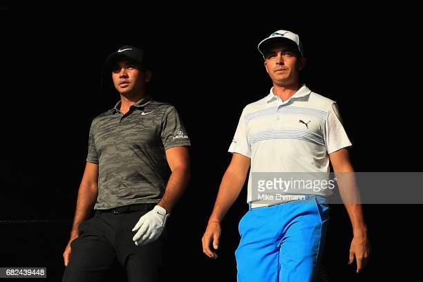 Jason Day of Australia and Rickie Fowler of the United States walk to the 18th tee during the second round of THE PLAYERS Championship at the Stadium...