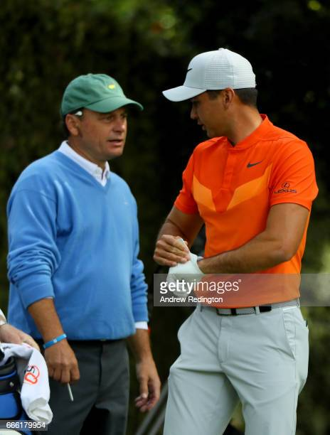 Jason Day of Australia and the Augusta National member Jeff Knox the noncompeting marker stand on the second tee during the third round of the 2017...