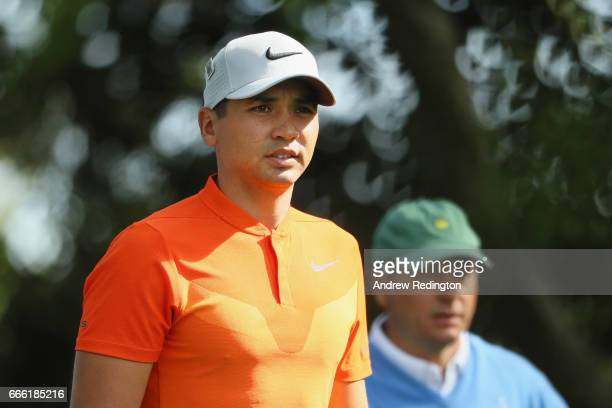 Jason Day of Australia and the Augusta National member Jeff Knox the noncompeting marker walk off the second tee during the third round of the 2017...