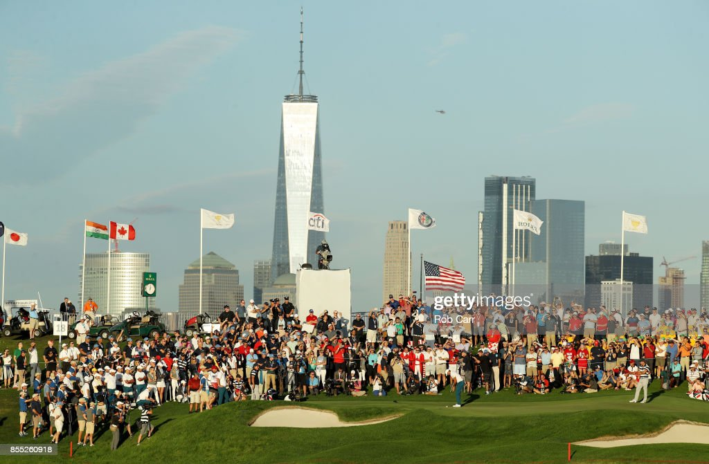 Jason Day of Australia and the International Team putts on the 18th green as he and Marc Leishman of Australia and the International Team play against Kevin Kisner and Phil Mickelson of the U.S. Team during Thursday foursome matches of the Presidents Cup at Liberty National Golf Club on September 28, 2017 in Jersey City, New Jersey.