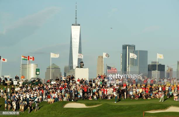 Jason Day of Australia and the International Team putts on the 18th green as he and Marc Leishman of Australia and the International Team play...