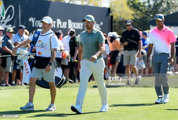 Jason Day of Australia and Tiger Woods leave hole No 10 during the second round of the Arnold Palmer Invitational presented by MasterCard at Bay Hill...
