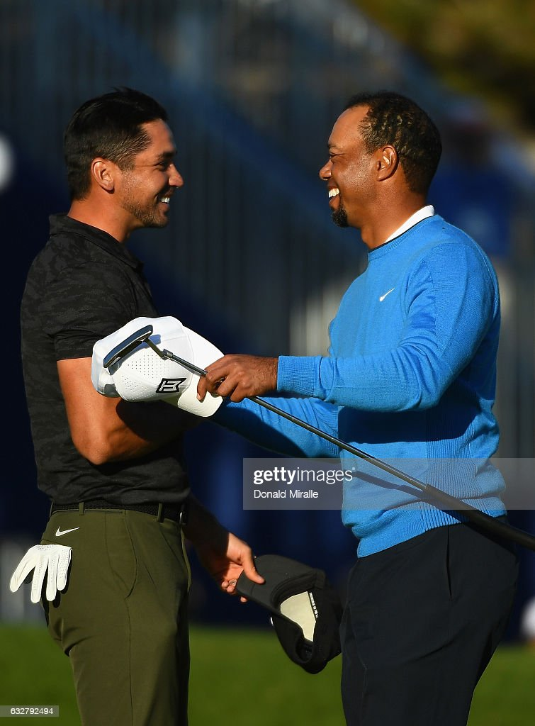 Jason Day of Australia and Tiger Woods shake hands after their round on the 18th hole during the first round of the Farmers Insurance Open at Torrey Pines South on January 26, 2017 in San Diego, California.