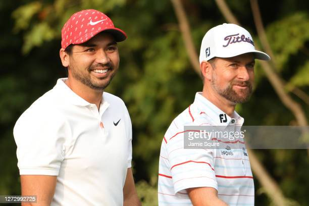 Jason Day of Australia and Webb Simpson of the United States look on from the 12th tee during the first round of the 120th U.S. Open Championship on...