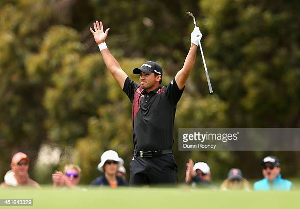 Jason Day of Australia celebrates gettting an eagle on the 6th hole during day four of the World Cup of Golf at Royal Melbourne Golf Course on...