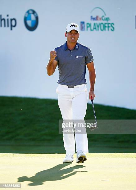 Jason Day of Australia celebrates on the 16th green during the Final Round of the BMW Championship at Conway Farms Golf Club on September 20 2015 in...