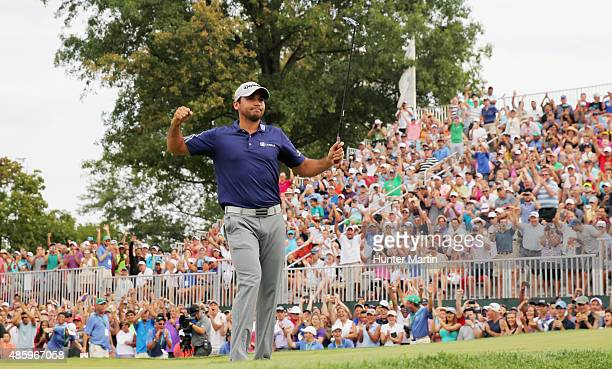 Jason Day of Australia celebrates on the 18th green after his sixstroke victory at The Barclays at Plainfield Country Club on August 30 2015 in...