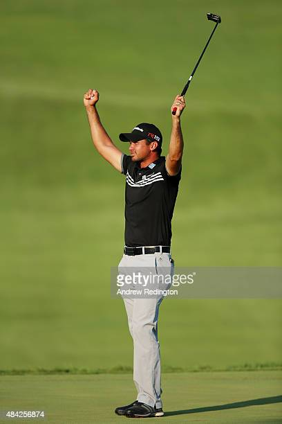 Jason Day of Australia celebrates on the 18th green after winning the 2015 PGA Championship with a score of 20-under par at Whistling Straits on...