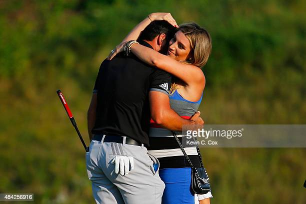 Jason Day of Australia celebrates on the 18th green with his wife Ellie after winning the 2015 PGA Championship with a score of 20under par at...