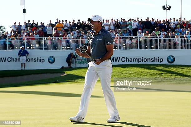 Jason Day of Australia celebrates winning the Final Round of the BMW Championship at Conway Farms Golf Club on September 20 2015 in Lake Forest...
