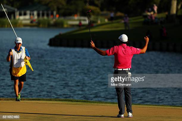 Jason Day of Australia celebrates with caddie Colin Swatton after winning during the final round of THE PLAYERS Championship at the Stadium course at...
