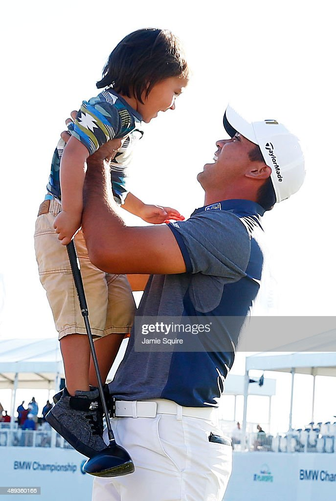 Jason Day of Australia celebrates with his son Dash after winning during the Final Round of the BMW Championship at Conway Farms Golf Club on September 20, 2015 in Lake Forest, Illinois.