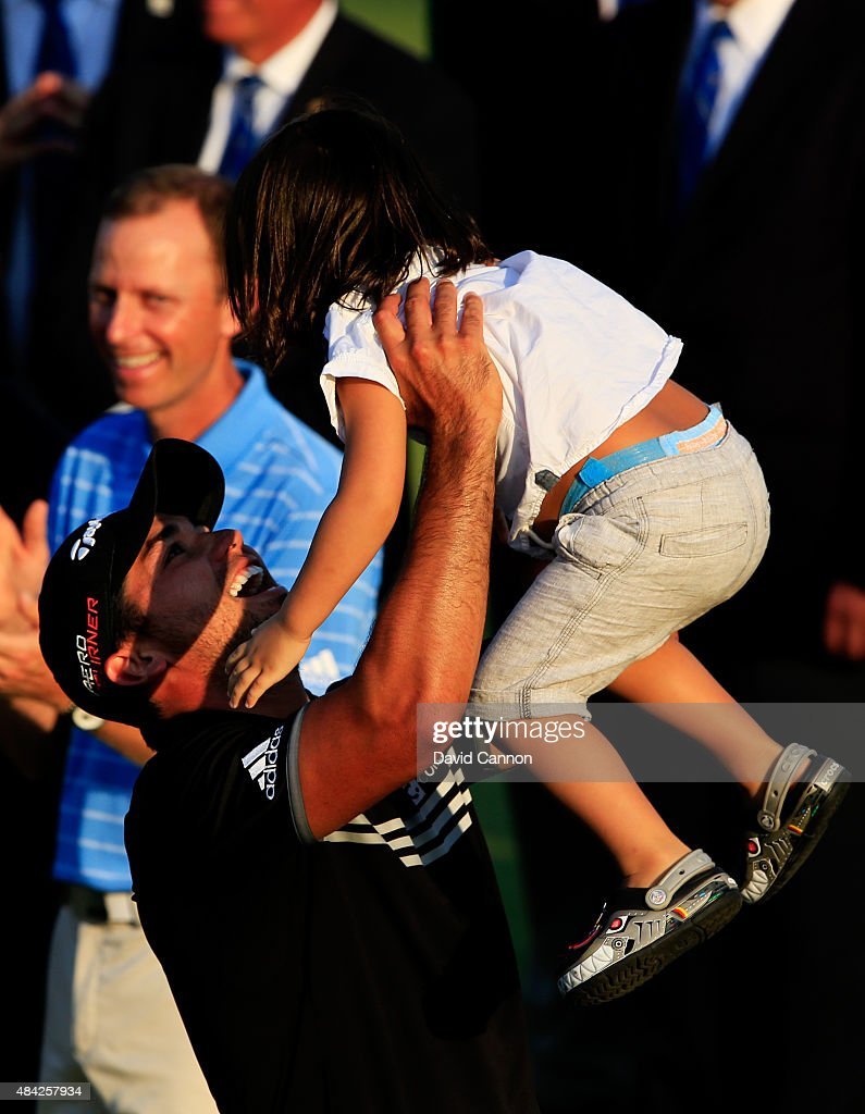 Jason Day of Australia celebrates with his son Dash after winning the 2015 PGA Championship with a score of 20-under par at Whistling Straits on August 16, 2015 in Sheboygan, Wisconsin.