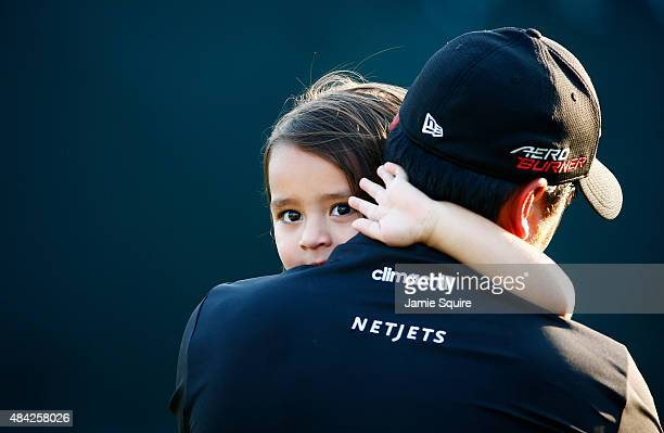 Jason Day of Australia celebrates with his son Dash after winning the 2015 PGA Championship with a score of 20under par at Whistling Straits on...