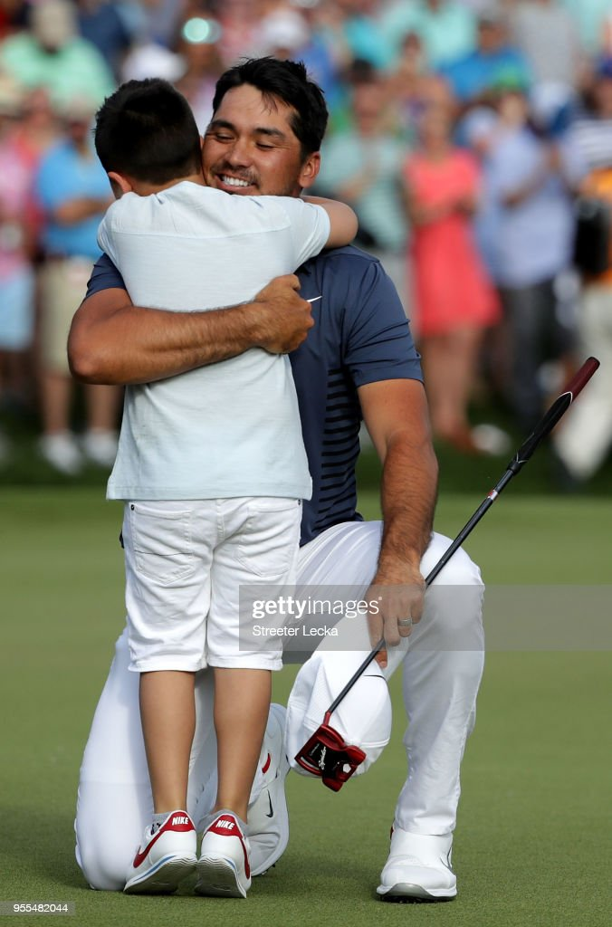 Jason Day of Australia celebrates with his son Dash on the 18th green during the final round after winning the 2018 Wells Fargo Championship at Quail Hollow Club on May 6, 2018 in Charlotte, North Carolina.
